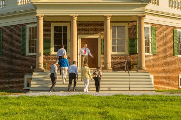 Visitors to Thomas Jefferson's Poplar Forest enjoy one of our historical tours on their way up the front stairs to enter the building.