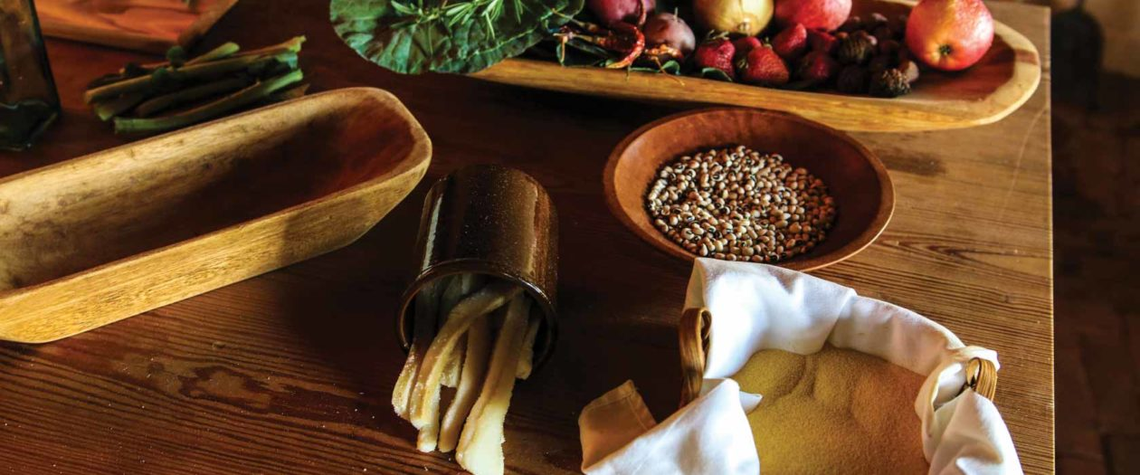 Produce and other cooking ingredients lay on a table in the kitchen of Thomas Jefferson's Poplar Forest.