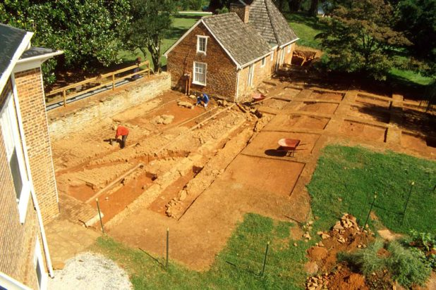 Excavators at work in the archaeological sites of Poplar Forest's Wing of Offices.