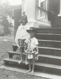 Key and Stephen Watts as children standing on the steps of the North Portico